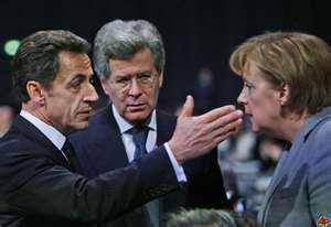 Der Jude Sarkozy (links), ehemaliger Präsident Frankreichs mit dem Büttel Angela Merkel, Kanzlerin der BRD (rechts)